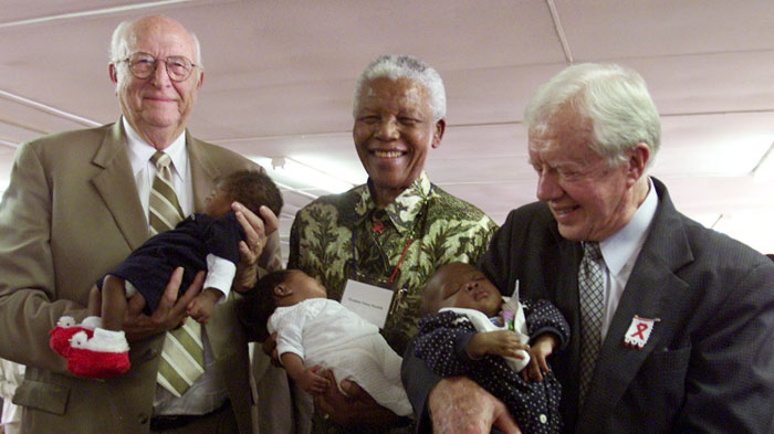 Nelson Mandela with Bill Gates, Sr., and former President Jimmy Carter