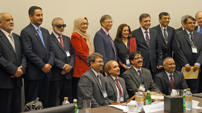 Bill and Melinda Gates with delegates at the Global Vaccine Summit