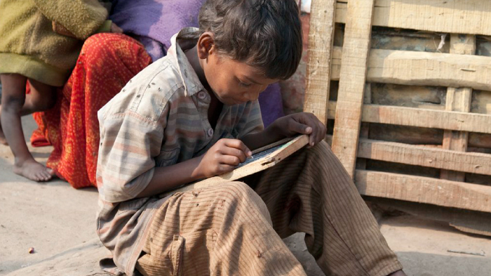 A Child Studies in the Street | GatesNotes.com The Blog of Bill Gates