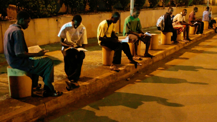 Students in Guinea Study Under Streetlights